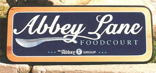 Abbey Lane food court carved sign.