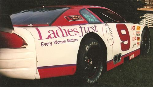 Ladies First sponsored race car graphics.