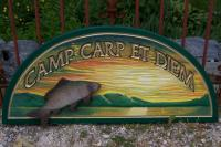 hand carved camp sign w/relief carved carp