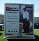 Digital of Service Technician on Rear of Truck